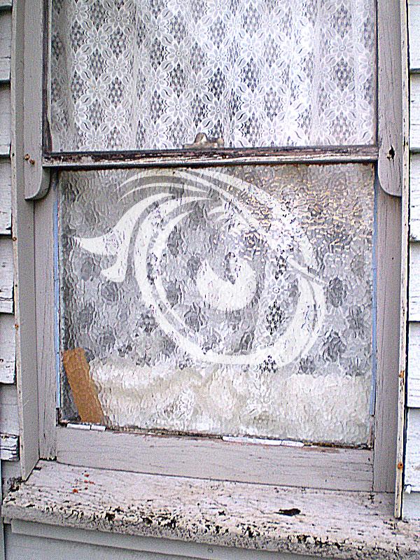 Wood rot to window sill and no putty around glass.